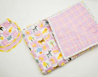 Pink baby quilt with animals