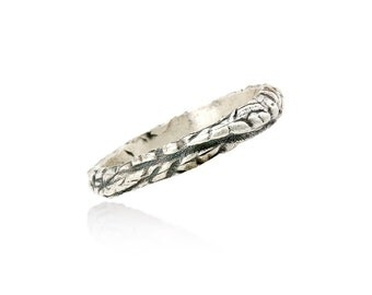 Blackened silver ring with tread pattern