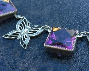 Vintage butterfly necklace with faceted violet stones