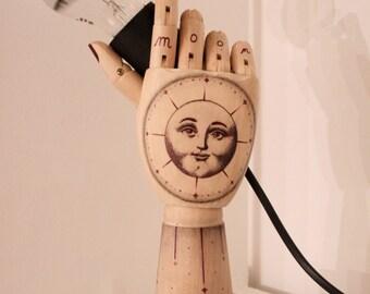 Handmade wooden lamp tattooed on concrete base