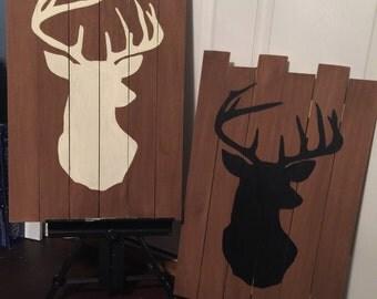 Deer silhoutte on wood panels