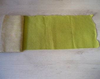 Upholstery fabric in a lime green colour