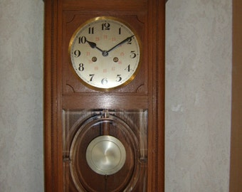 Antique Black Forest wall clock in a country house style