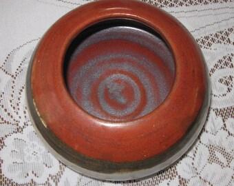 stoneware orange and beige bowl