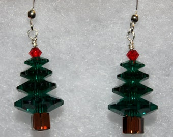 Green Christmas trees w/ dark brown trunk