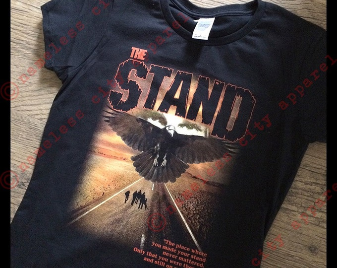 The Stand - The Dark Man - Randall Flagg watches at nameless city apparel - Stephen King's horror novel gets a new shirt! ladies fit