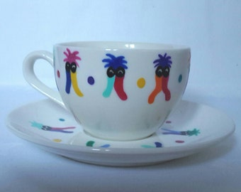 Hand Painted Mome Raths tea cup (175ml) and saucer (14.5cm) , inspired by Disney Alice in Wonderland