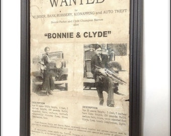 Bonnie and Clyde aged reproduction Wanted poster in frame.