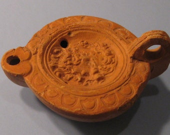 Roman Pottery Oil Lamp with Head of Jupiter, Late 1st - 2nd Century AD