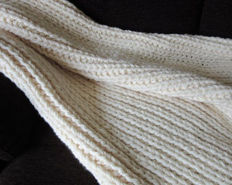 Hand knitted, cream coloured throw / blanket