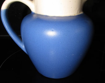 Blue and  white pottery jug with 'Lynmouth' etched on one side