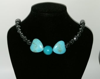 Hematite necklace with turquoise bow
