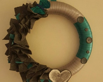 Lovely wreath with deep teal and dark grey accents.