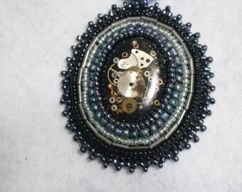 metallic blue and black bead embroidered pendant