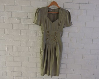 Vintage 1950s CUE DESIGNS fitted dress with shoulder pads