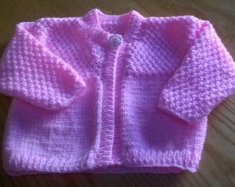 A Hand Knitted Pink Baby Cardigan