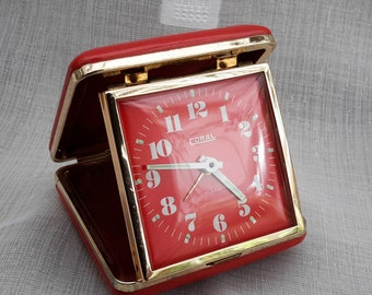 Red Coral Travel Alarm Clock, Coral Clock in Red case, wind up travel alarm, clock in working order, alarm needs attention.