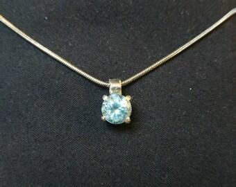 Handmade blue topaz and silver pendant