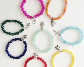 Jade colored bracelets with silver pendants