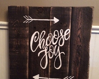 Rustic wood sign made from reclaimed wood