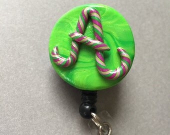 Polymer clay pink and green twist initial retractable ID badge holder with alligator clip