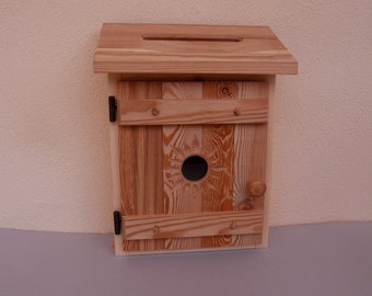 Mail box from wooden rustic with a Sun motif