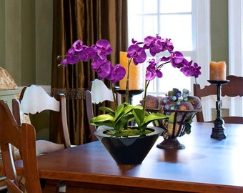 Artificial Purple Orchids in Black Planter