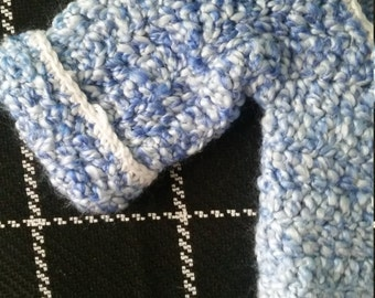 Blue fuzzy crocheted baby sweater