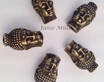Buddha head brass bead priced as a pair