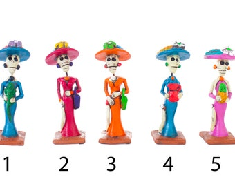 Mini Catrin and Catrinas clay figurines hand painted mexican day of the dead colorful skeletons skulls