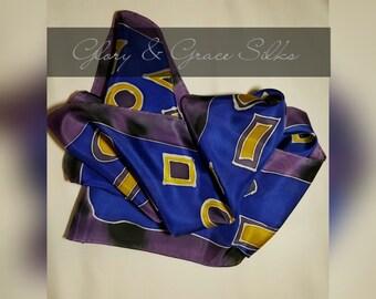 "Geometric, hand painted silk.  Squares, Circles, Triangles, Rectangles, purple, yellow, blue. Approx 70""x8""  GloryandGraceSilks"