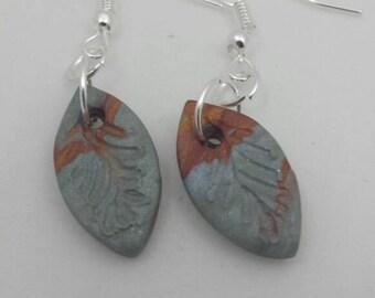 Silver and burgundy leaf
