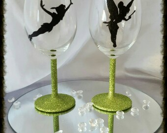 hand painted Peter pan and tinkerbell glitter wine glass