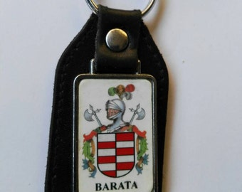 Keychains with the coat of arms of your last name.