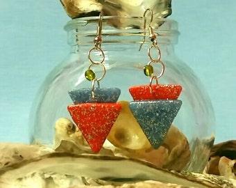 Two-tone triangle earring.