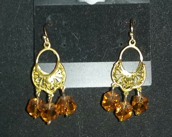 Gold with yellow gem earrings