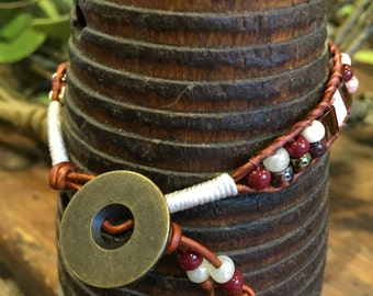 Handmade leather wrap bracelet. Glass beads and brown leather