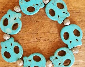 Aqua Skulls and Silver Bead Bracelet.