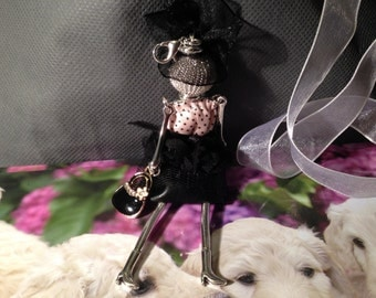 Doll metal costume to wear in necklace or keychain