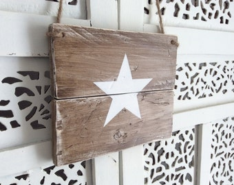 Wooden sign made of wooden pallets with white star