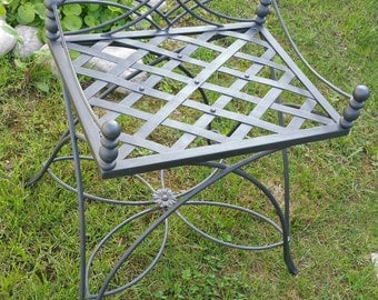 Forged wrought iron chair and entirely handmade in style and taste of the artist.