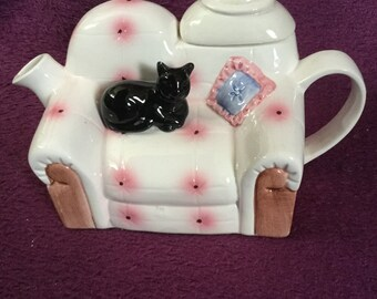 Decorative cat on a sofa teapot