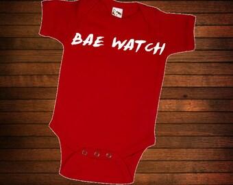 BAE WATCH ONESIE