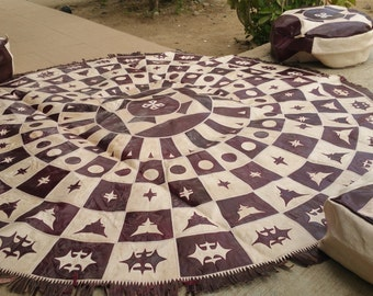 Vintage Round leather rug with 3 pouf set. Handmade traditional African Nomad design. Patch pattern.