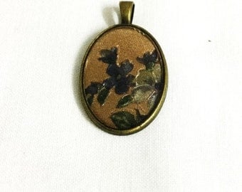 Oval Shaped Pendant with Flower Designs