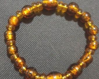 Amber and golden beaded bracelet
