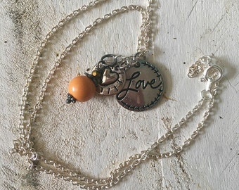 Love necklace with heart pendant and orange bead charm - silver necklace