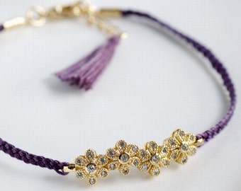 Purple daisy chain friendship bracelet