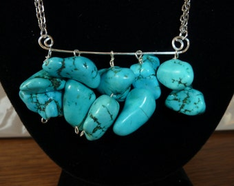 Silver necklace with turquoise nuggets