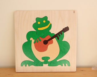 Frog with guitar  a wooing he did go